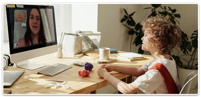 A boy taking an online course from home