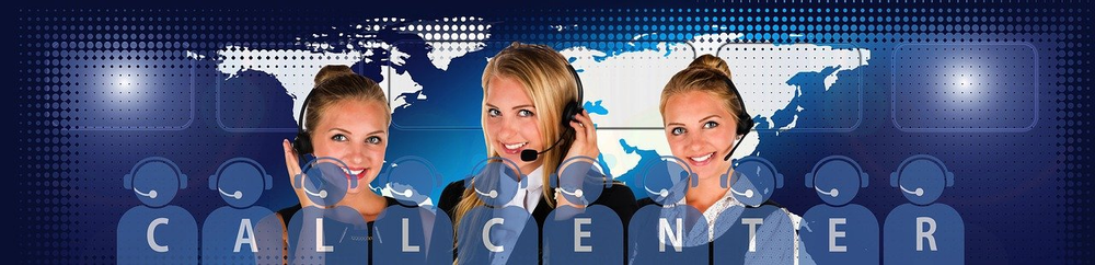Three women with headsets working in a call center