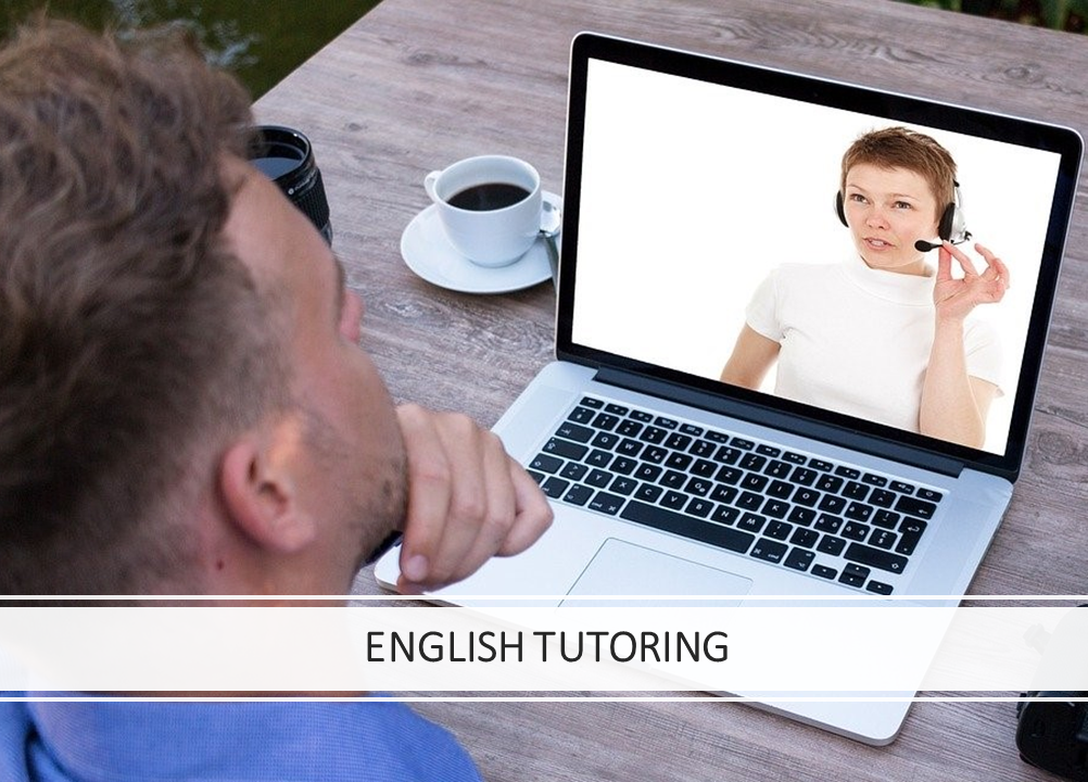 Man taking English online classes at home with female tutor on the computer
