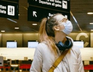 People at the airport with masks on