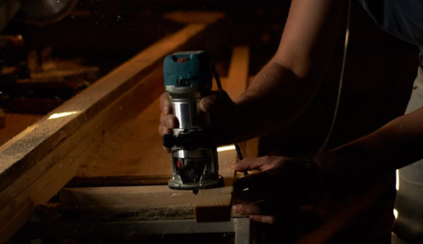 Man using power tools for woodworking tasks